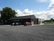 Reconstruction d''une infrastructure sportive existante et aménagement d'un parking
